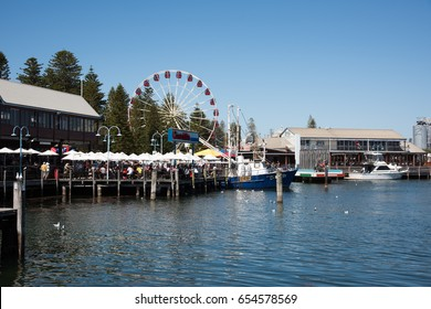 Cicerello's,people,ferris wheel and harbor in Fremantle,Western Australia/Harbor Lifestyle/FREMANTLE,WA,AUSTRALIA-NOVEMBER 13,2016:Cicerello's, people in harbour scene in Fremantle,Western Australia