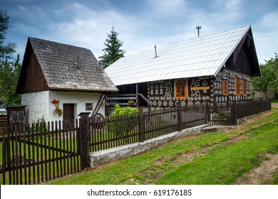 Cicmany, Slovakia - august 02, 2015: Old wooden houses in Slovakia village Cicmany, traditional painted with white paint. Cicmany, Slovakia