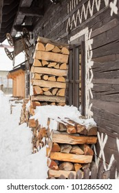 Cicmany, Slovakia. Old wooden houses in Slovakia village Cicmany in winter. The ornaments from Cicmany, and the Slovak folk pattern. The village of Cicmany is on the list of UNESCO.
