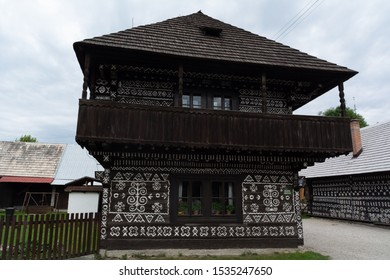 Cicmany, Zilina / Slovakia - June 16, 2018:  Traditional house with  geometric white paintings as a decoration, in a mountain village.