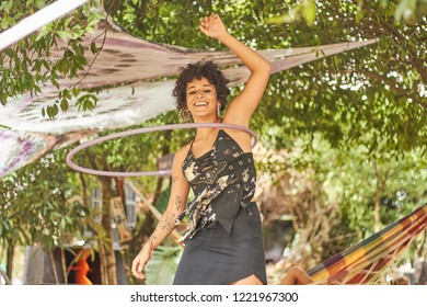 Cidade dos canyons, RS / Brazil - March 2018 : Unidentified girl with a hula hoop, dancing and having fun, at a alternative trance music festival