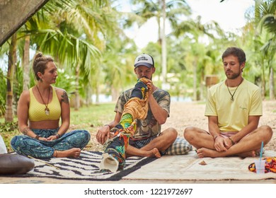 Cidade dos canyons, RS / Brazil - March 2018 : Unidentified people, playing didgeridoo, unusual and cool instrument, at a trance music festival chill out, alternative culture