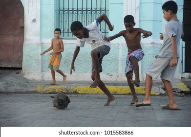 Cienfuegos, Cuba 12/8/2015: cuban children playing footbal in the street of Cienfuegos