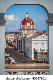 CIENFUEGOS, CUBA - CIRCA AUGUST 2015: Framed view of Town Hall and Museo Provincial in Cienfuegos, Cuba