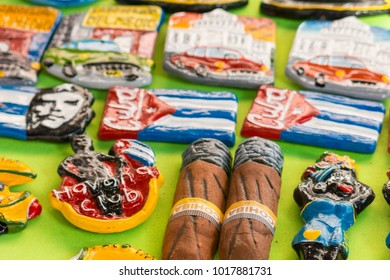 CIENFUEGOS, CUBA - JANUARY 3, 2017: Cuban national flags, palm, Che Guevera portraits and other fridge magnet / souvenirs typical for Cuba sold in souvenir shop in street market in Cienfuegos, Cuba