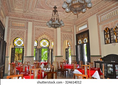 Cienfuegos, Cuba - July 24, 2014: the restaurant in the lavish interior of the Palacio de Valle in Cienfuegos, Cuba. The building is an architectural gem influenced by many styles, built in 1917.