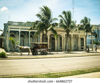 CIENFUEGOS, CUBA - MAY 5, 2009: City sketch with a horse and the colonial buildings