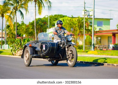 CIENFUEGOS, CUBA - SEPTEMBER 12, 2015: Classic motorcycle with sidecar are still in use and old timers have become an iconic view