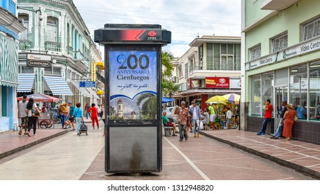 Cienfuegos, Cuba-February 10, 2019: The city pedestrian boulevard or promenade. Symmetric view with a an advertisement board in the center.   The city is celebrating 200 years since its foundation.