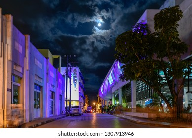 Cienfuegos, Cuba-January 29, 2019:  Hotel America in the downtown district. Night image with the moon in the sky. The area is a famous tourist attraction in the central city of the Caribbean island