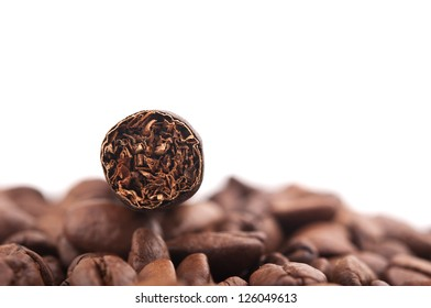 cigar and coffee beans isolated on white