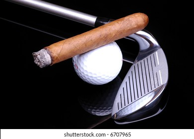 Cigar on Golf Ball and Golf Club on black background with reflections