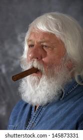 Cigar - senior with full white beard and cigar