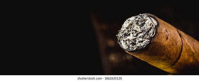 cigar tip detail, isolated on dark background