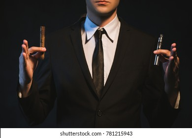 Cigar vs e-cigarette. Man has a choice between traditional and modern way of smoking. Healthy alternative to tobacco