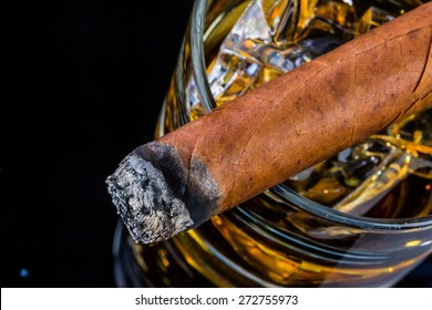 cigar and whiskey. a symbol photo for addiction and related