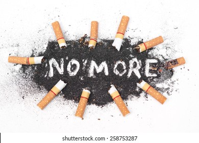 cigarette ash with text saying no more