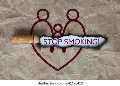 Cigarette burning paper with heart-shaped family brown.Concept quit,stop smoking and world no tobacco day