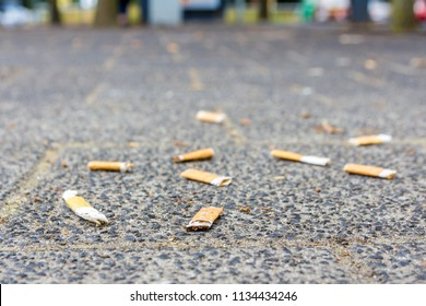 cigarette butts on the street smoking is bad for your health