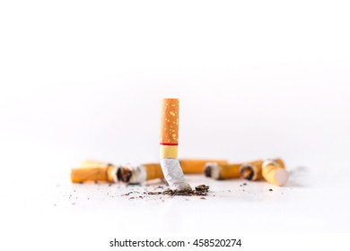 Cigarette butts on a White background / cigarette butts / cigarette