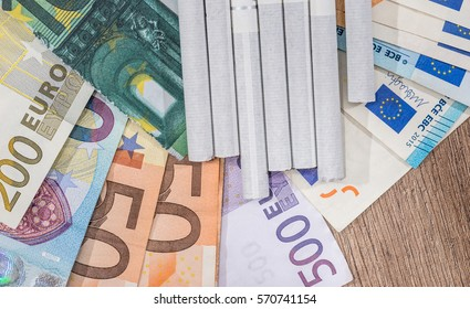 cigarette with euro bills. close up.