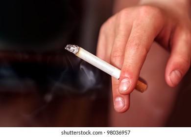cigarette in a hand closeup