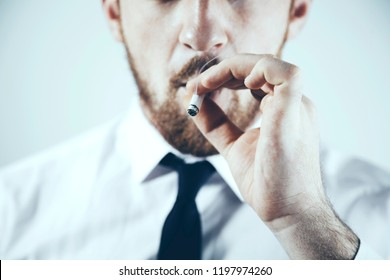 Cigarette in the hands of a  businessman
