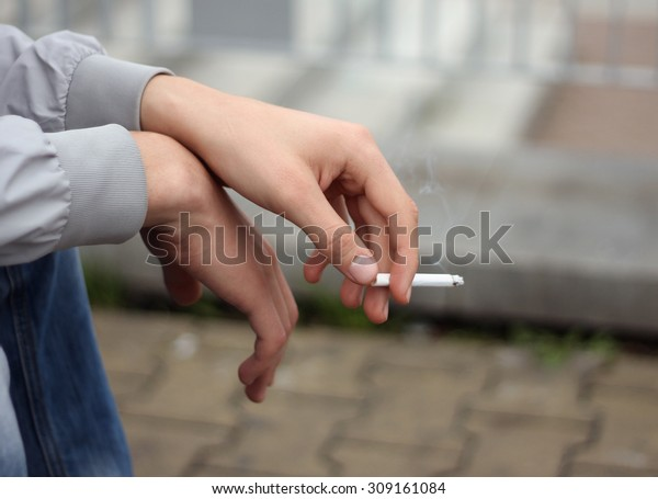 cigarette in the hands of men - close-up