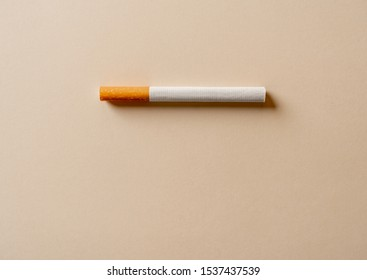 Cigarette isolated. Conceptual image with copy space for text. Advertising style of stop smoking, smoking causes disease, dangers of tobacco, nicotine addiction and medical warning.
