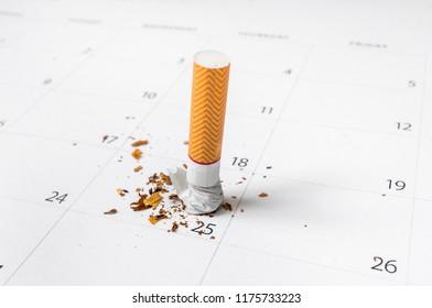 Cigarette on a calendar background - quit smoking concept