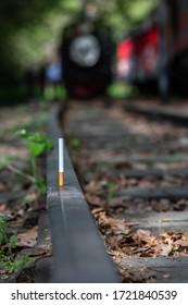 Cigarette on train track. Single cigarette .