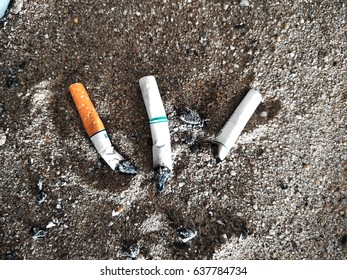 A cigarette in sand ashtray.Bad addiction. Ashtray and cigarettes close-up.