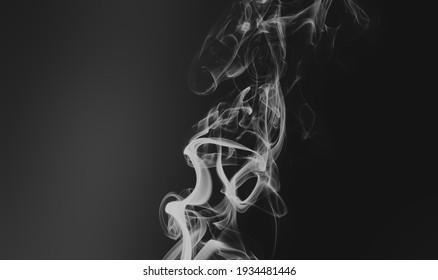Cigarette smoke in the dark room. Healthcare concept