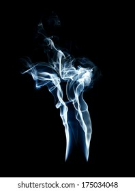 cigarette smoke on black background