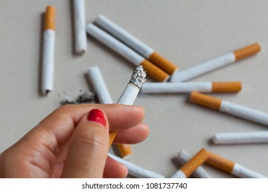 cigarette smoking  smoker nicotine woman addiction quit concept The cigarette in the girl's hand.