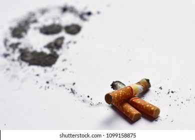 cigarettes and ash tranform to dead skull sign with copy space on white background , world no tobacco day concept