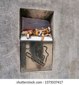 Cigarettes in an ashtray on the wayside in Pula in Croatia
