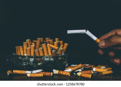 Cigarettes and ashtrays White and black background isolated