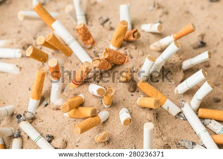 Cigarettes butt in sand ashtray