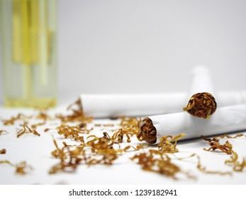 Cigarettes, Cigarette lighter, Cigarettes and cigarette lighter on white background, Close up of cigarettes. Quit smoking, World No Tobacco Day.