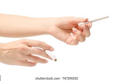 The cigarettes female hand on white background isolation