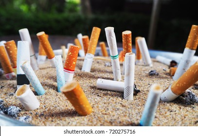 Cigarettes are then left in the ashtray in the smoking area