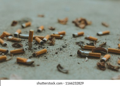 Cigarettes scattered all over the street.