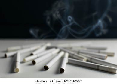 Cigarettes shrouded in smoke.
