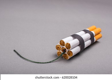 Cigarettes are a time bomb. Cigarettes cause cancer and kill. Empty place for text. Gray background