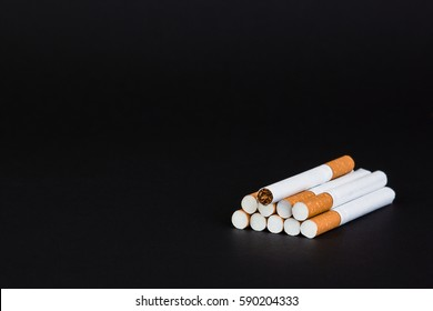Cigarettes, tobacco, close-up on a black background.