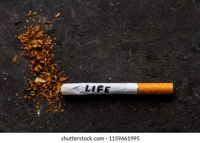 Cigarettes, tobacco on a black background. Treatment of nicotine addiction. Danger to life. Smoking concept