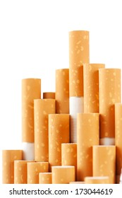 Cigarettes with the yellow filter on white background