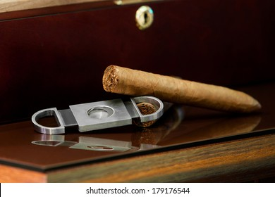 cigars and a cutter on a wooden.