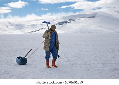 Cildir Lake (Cildir Golu) - January 2018: Fisherman coming from work in Ardahan, Turkey